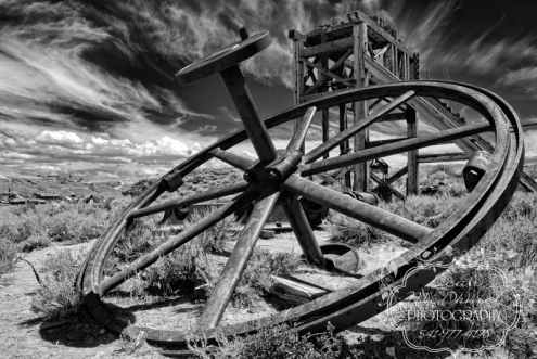 Single Image Big Wheel with Red Cloud Mine Head Frame in the Background